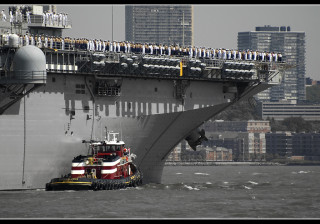 USS Wasp gets some help steering up the Hudson river from tug Ellen McAllister.